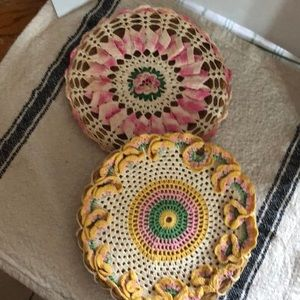 Vintage doilies attached to wicker plate